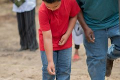 a-young-boy-Learning-how-to-plant-a-garden